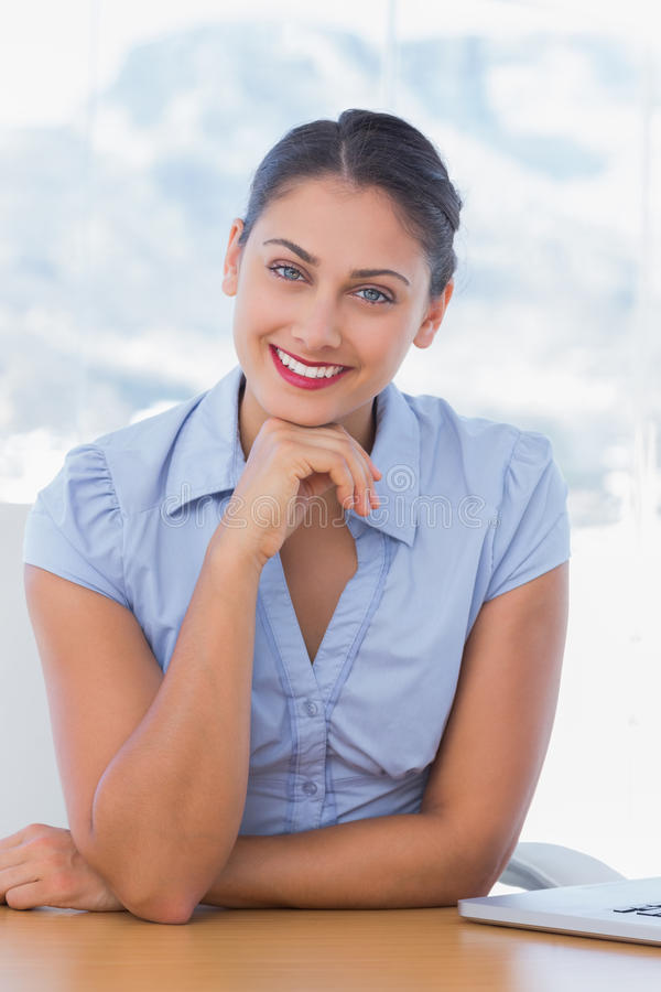 Download Cheerful Businesswoman Sitting At Her Desk Stock Image - Image: 31447883