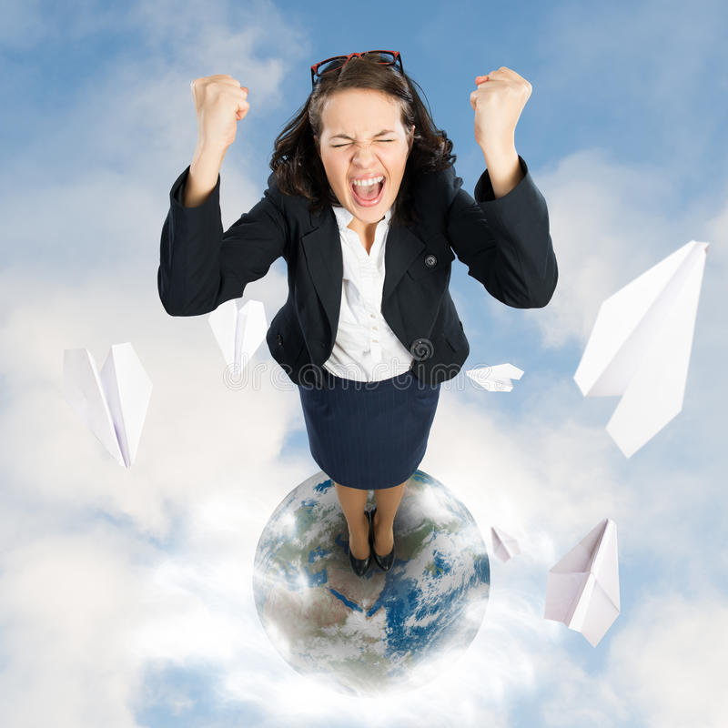 Cheerful businesswoman. Top view of businesswoman celebrating success with arms up. Elements of this image are furnished by NASA stock images