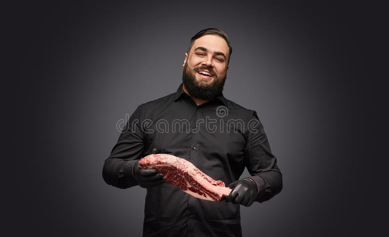 Cheerful butcher with fresh meat royalty free stock photography