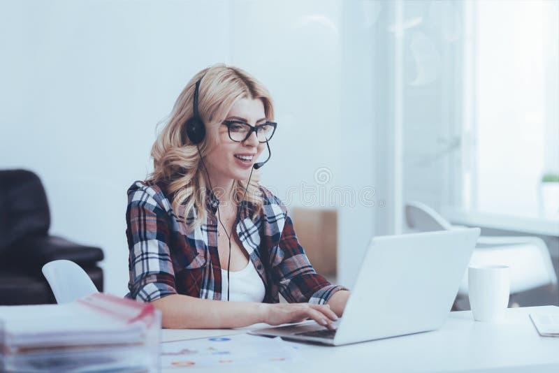 Cheerful call center operator working stock photos