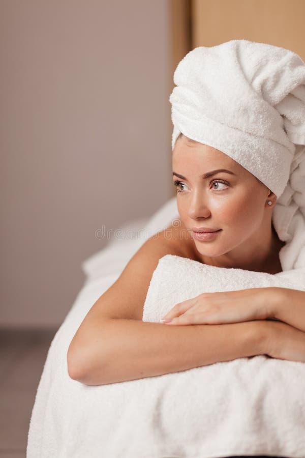 Cheerful careless girl lying at home stock image