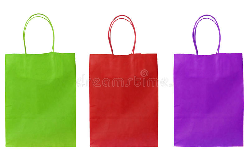 Cheerful carrier/shopper bags. Three bright and jolly bags isolated on white royalty free stock photos