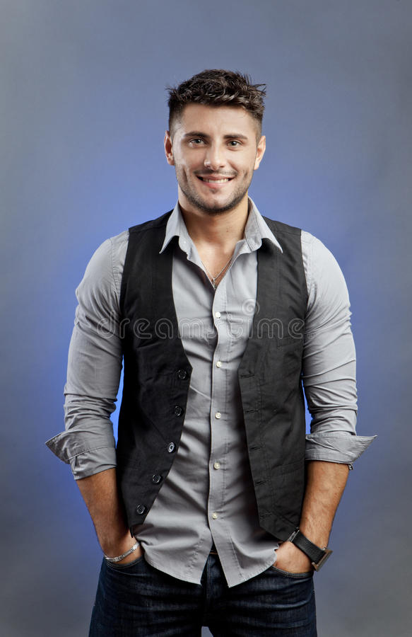 Cheerful casual man. Cheerful man on studio background, smiling royalty free stock photos