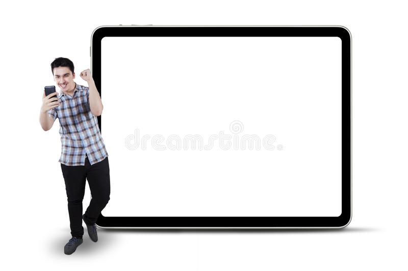 Cheerful casual man reading good news royalty free stock photography