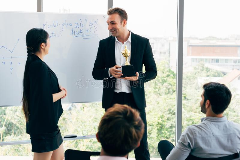 Boss awarding workers during conference royalty free stock photography