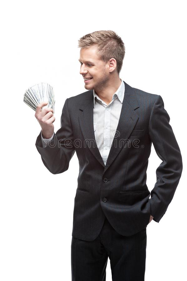Young businessman in suit holding money isolated on white background stock image