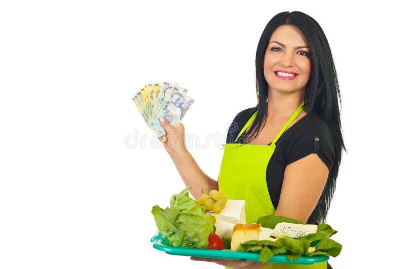 Cheerful cheese maker holding money stock photo