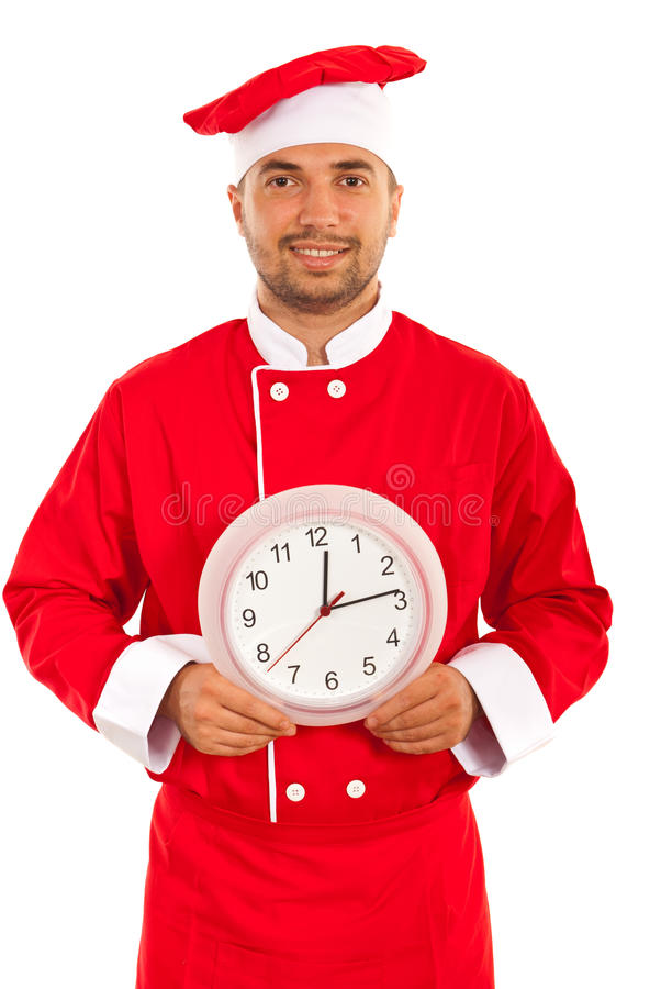 Cheerful chef with clock. Isolated on white background stock image