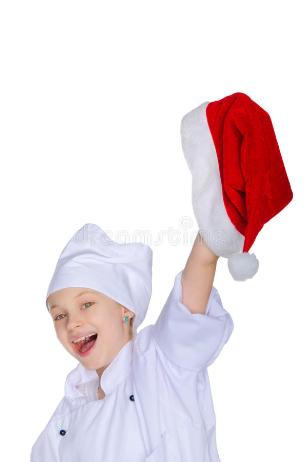 Cheerful chef girl with Santa hat stock photography