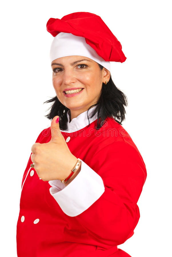 Cheerful chef woman gives thumb up royalty free stock image