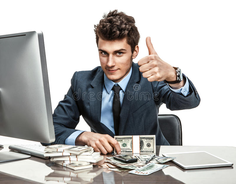 Cheerful chief showing thumbs up success sign. Modern businessman at the workplace working with computer royalty free stock photos