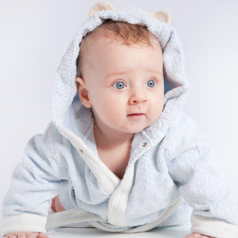 Cheerful child in bathrobe royalty free stock image