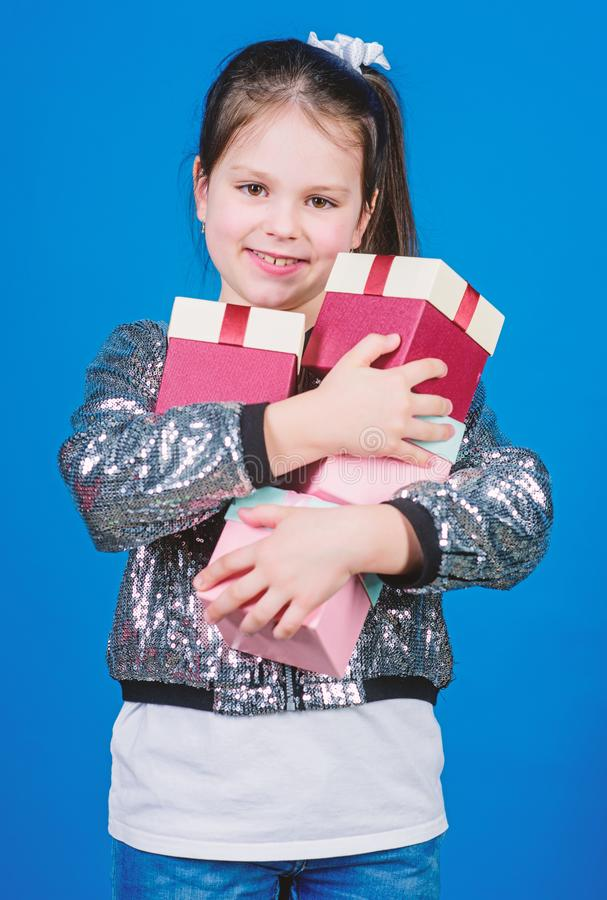 Cheerful child. Little girl with gift. Small girl has present box. Happy birthday. Holiday celebration. Surprise. Children day. Congratulation. Boxing day royalty free stock images