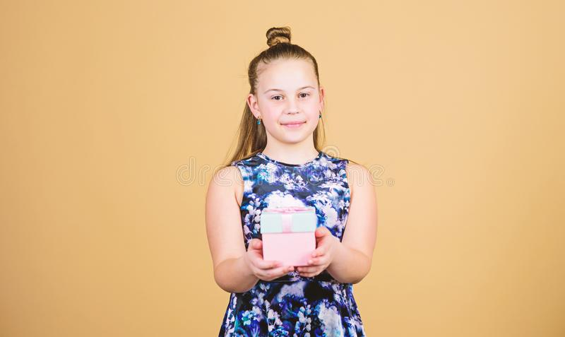 Cheerful child. Little girl with gift. Surprise. Childrens day. Congratulation. Happy birthday. Holiday celebration. Boxing day. Christmas shopping. Small girl royalty free stock image