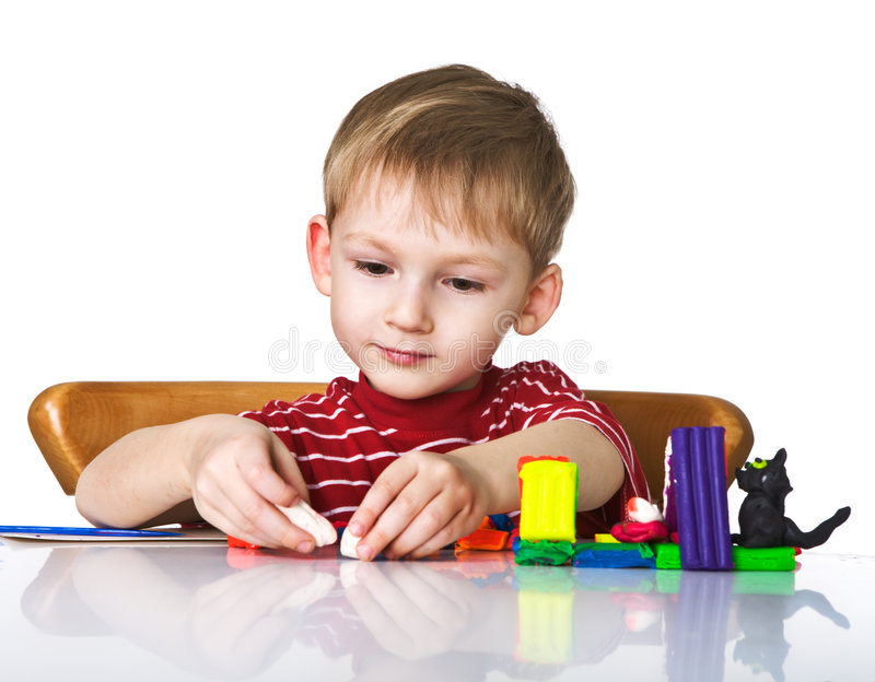 Download Cheerful Child With Plasticine Stock Photo - Image: 7277322