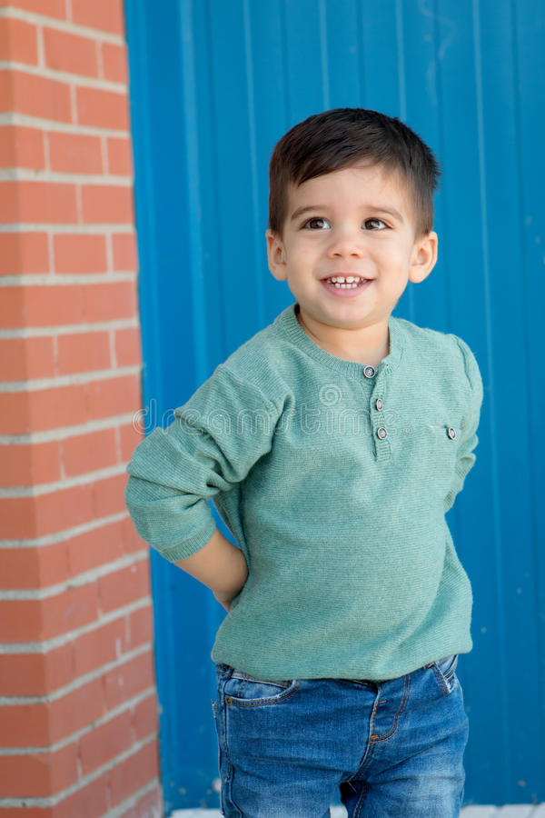 Cheerful child with two years on the street royalty free stock photo