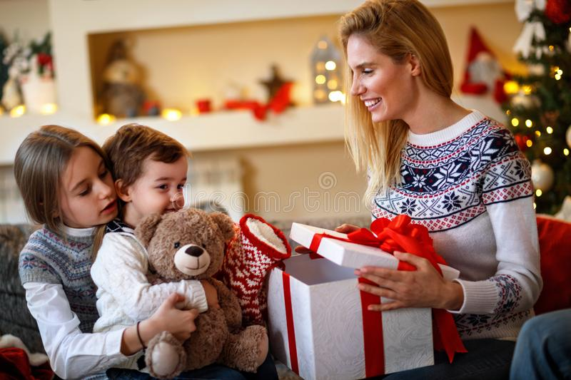 Cheerful children looking Christmas gifts stock photos