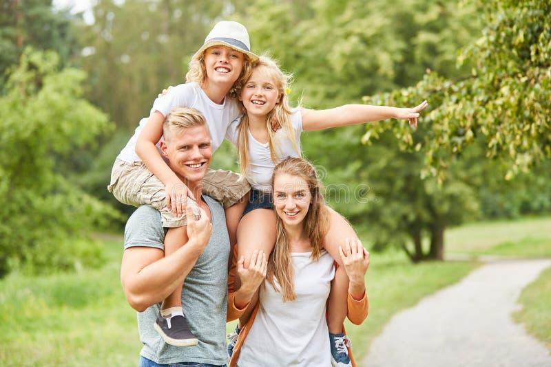 Cheerful children ride piggyback stock images