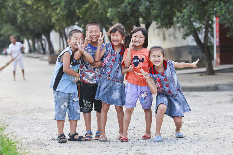 Cheerful Chinese teens on the street stock photo