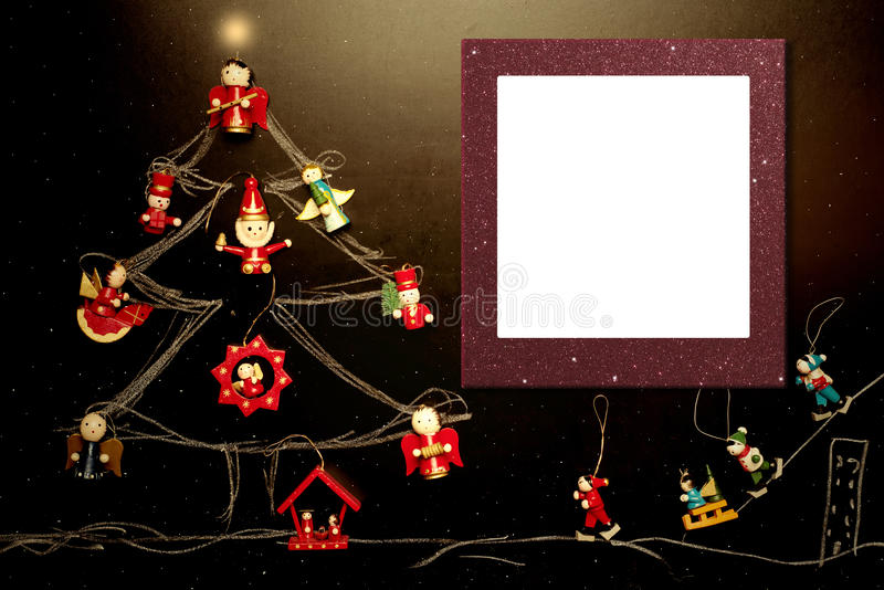 Cheerful Christmas photo frame, skiers card. Cheerful Christmas photo frame card, childlike drawing of christmas tree on a blackboard with figures of skiers and royalty free stock photo