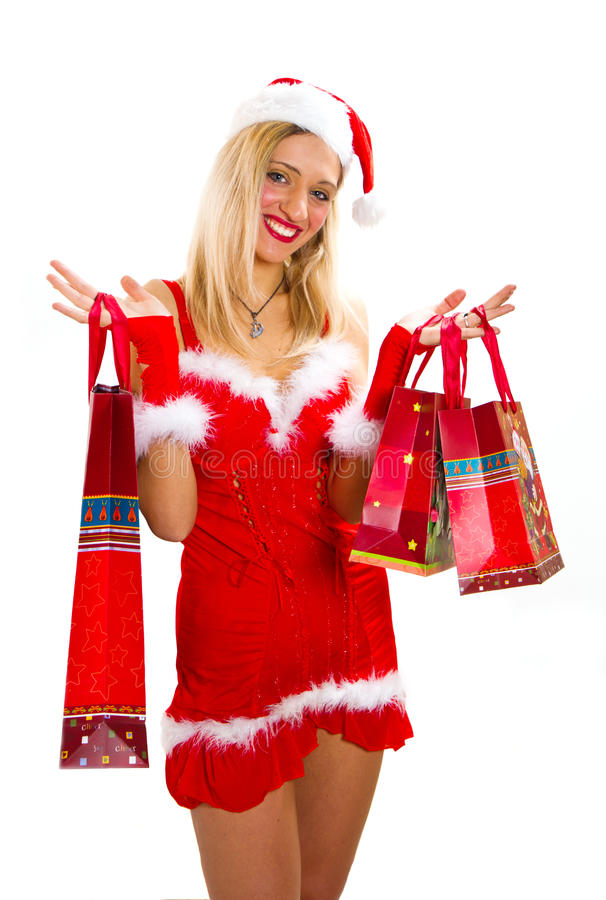 Cheerful christmas woman in santa's wear smiling stock photos