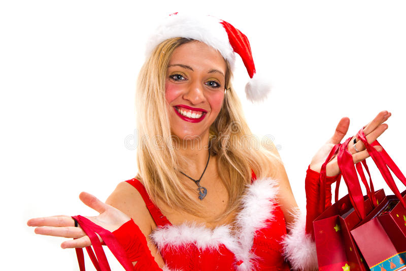 Cheerful christmas woman in santa's wear smiling royalty free stock photography