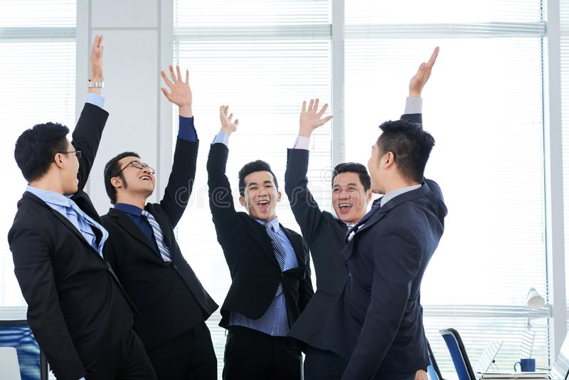 Cheerful Colleagues Giving High Five stock image