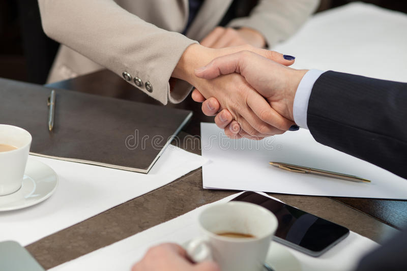 Cheerful colleagues are ready to sign a contract royalty free stock images