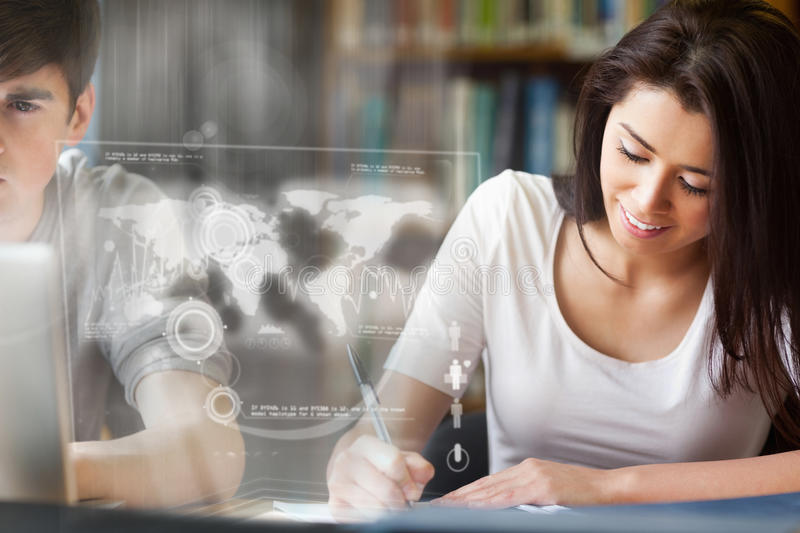 Cheerful college student analysing map on digital interface royalty free stock photos