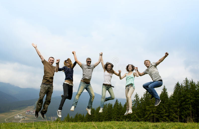 Cheerful company of young friends royalty free stock photography