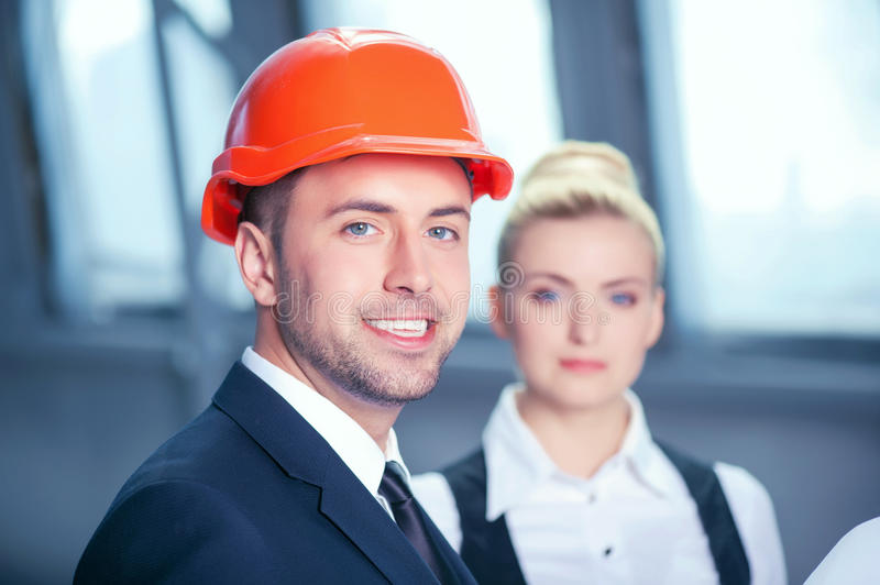 Cheerful construction team are planning new stock photos