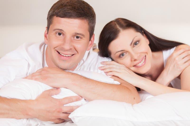 Cheerful couple awaking and lying happy. royalty free stock photo
