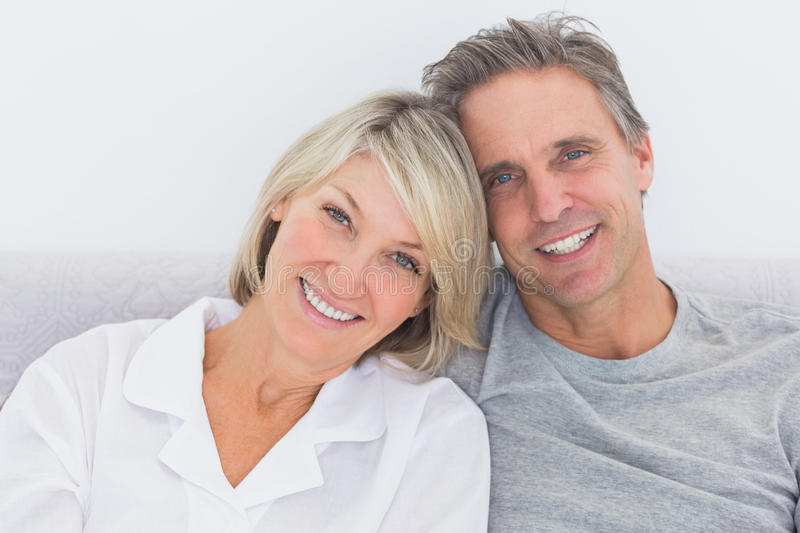 Cheerful couple in bed royalty free stock images