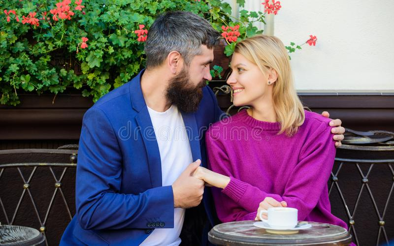 Cheerful couple. Couple in love on romantic date. First meet of girl and mature man. Brutal bearded hipster and girl royalty free stock photos