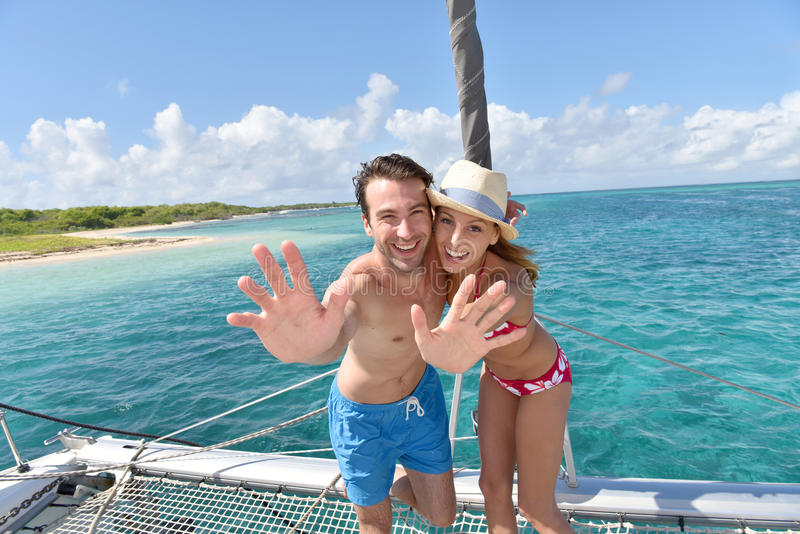 Cheerful couple on the deck of sailing boat in caribbean sea royalty free stock image