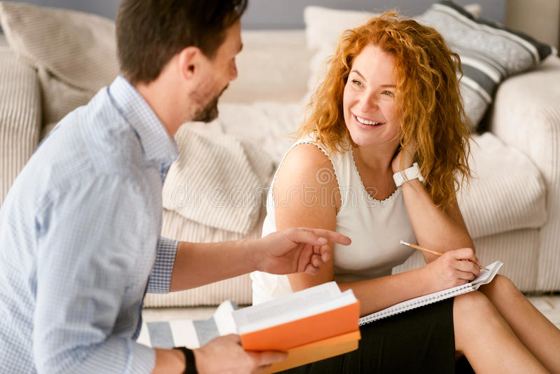 Cheerful couple discussing the project at home royalty free stock images