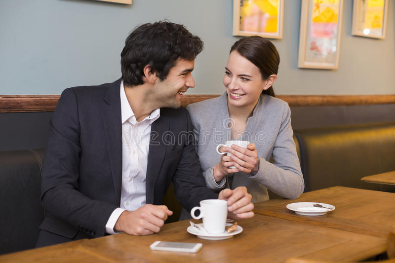 Download Cheerful Couple Flirting At Coffee Bar Table Stock Photo - Image: 38972662