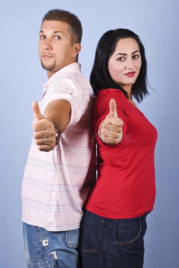 Cheerful Couple Give Thumbs Up Royalty Free Stock Images
