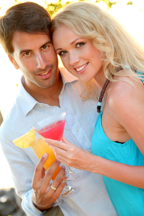 Download Cheerful Couple Having A Drink Stock Photo - Image: 22065290