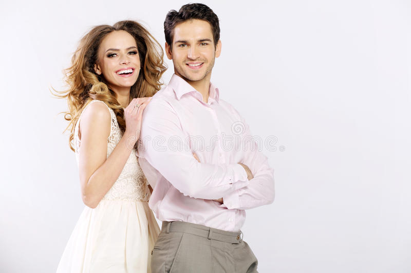 Cheerful couple having great time together stock images