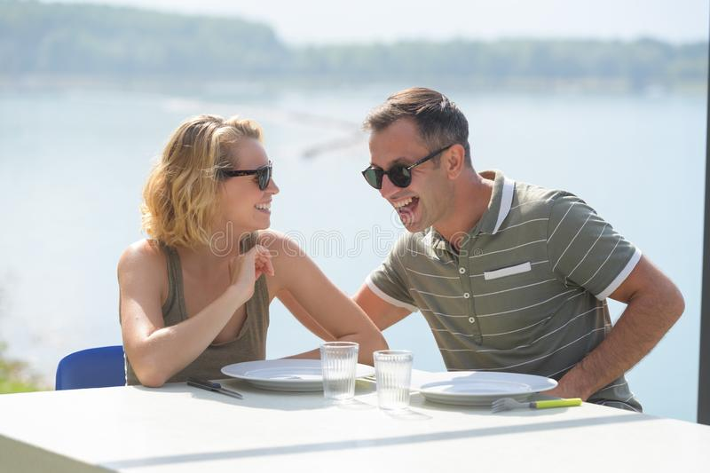 Cheerful couple having lunch outdoors royalty free stock images