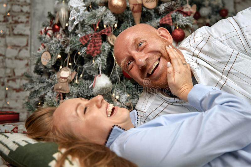 Cheerful couple hugging, enjoying together on Christmas Eve. Christmas concept in anticipation of a miracle, family. Marriage, young couple for the new year royalty free stock images