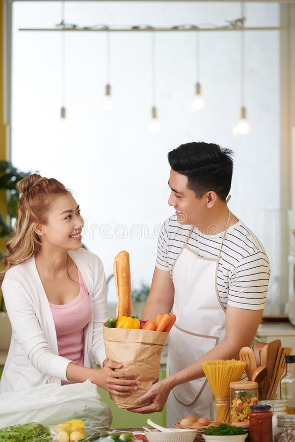 Cheerful couple in kitchen royalty free stock image