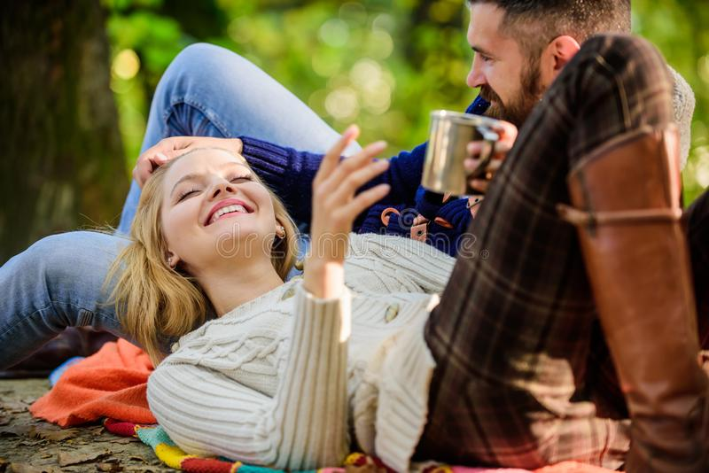 Cheerful couple. couple in love relax in autumn forest with tea or coffee. camping and hiking. happy woman and bearded stock image
