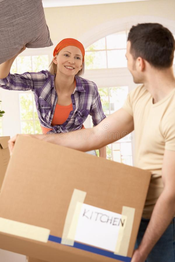 Cheerful couple at moving