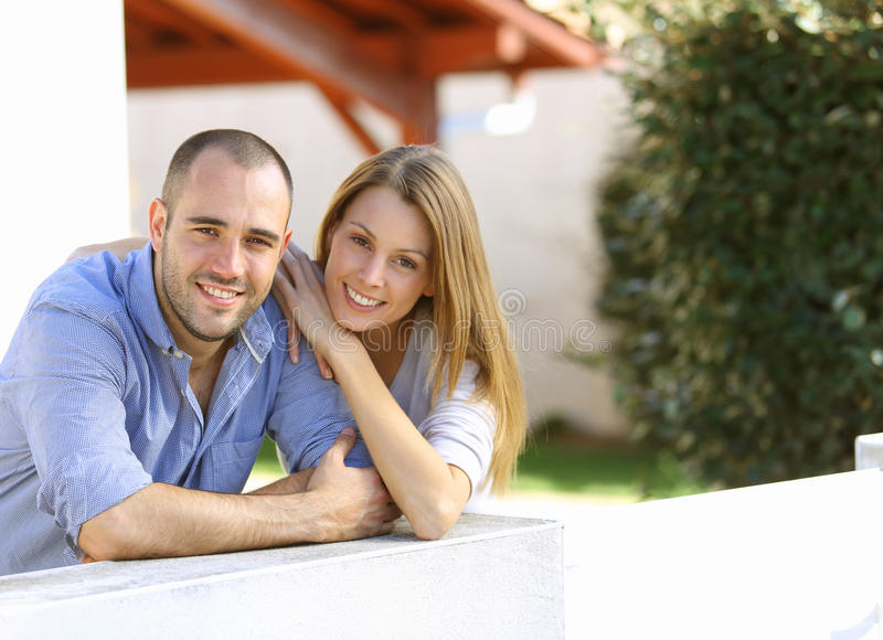 Cheerful couple standing in the yard stock photo