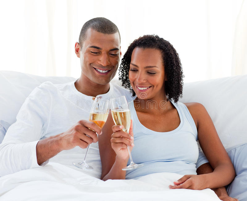 Cheerful couple toasting with Champagne stock photography