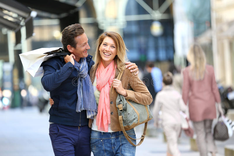 Cheerful couple in town shopping stock photo