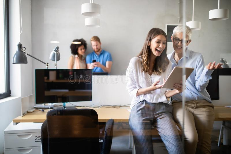 Cheerful coworkers in office during company meeting royalty free stock photos