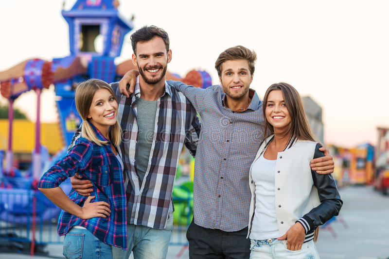 Cheerful crowd standing together outdoors stock images